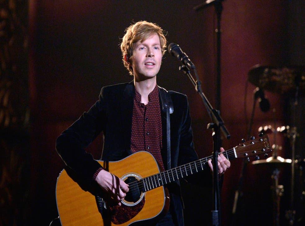 Beck sings.
