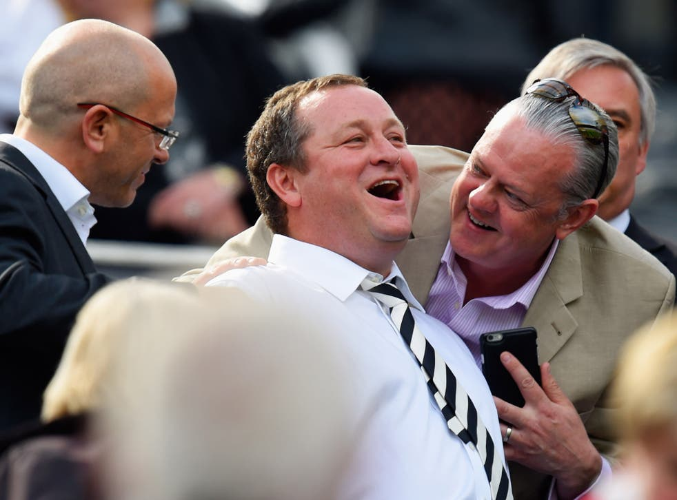 Mike Ashley (centre) has previously refused to give evidence to MPs about working conditions at his company