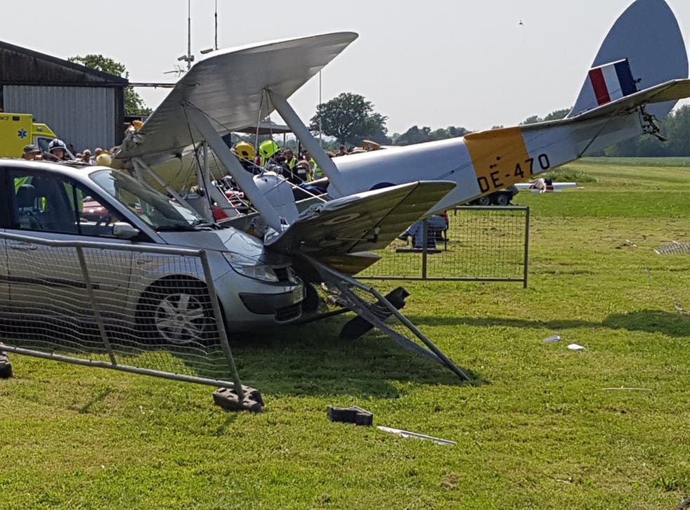 A Tiger Moth biplane hit a car after it crashed shortly after take-off yesterday at Brimpton Airfield near Reading