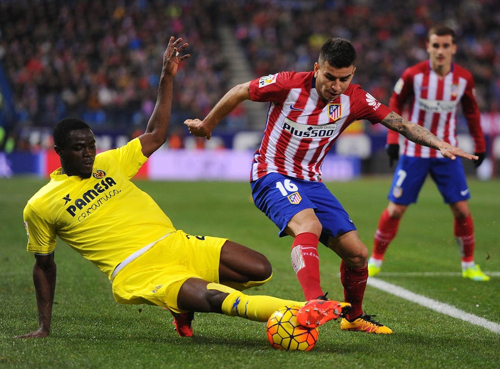 Bailly, left, challenging Atletico Madrid's Angel Correa