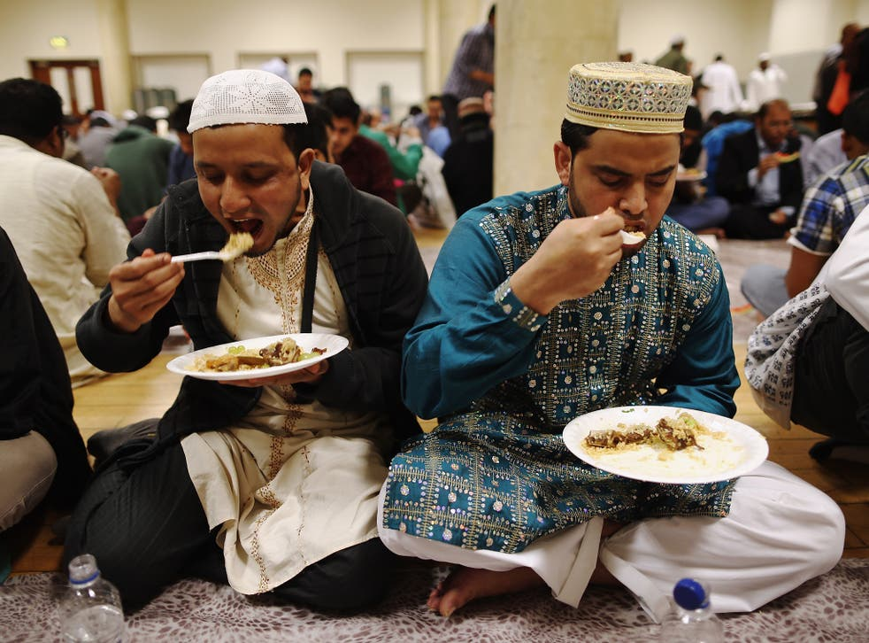 Muslims break their fast at East London Mosque on the last day of Ramadan