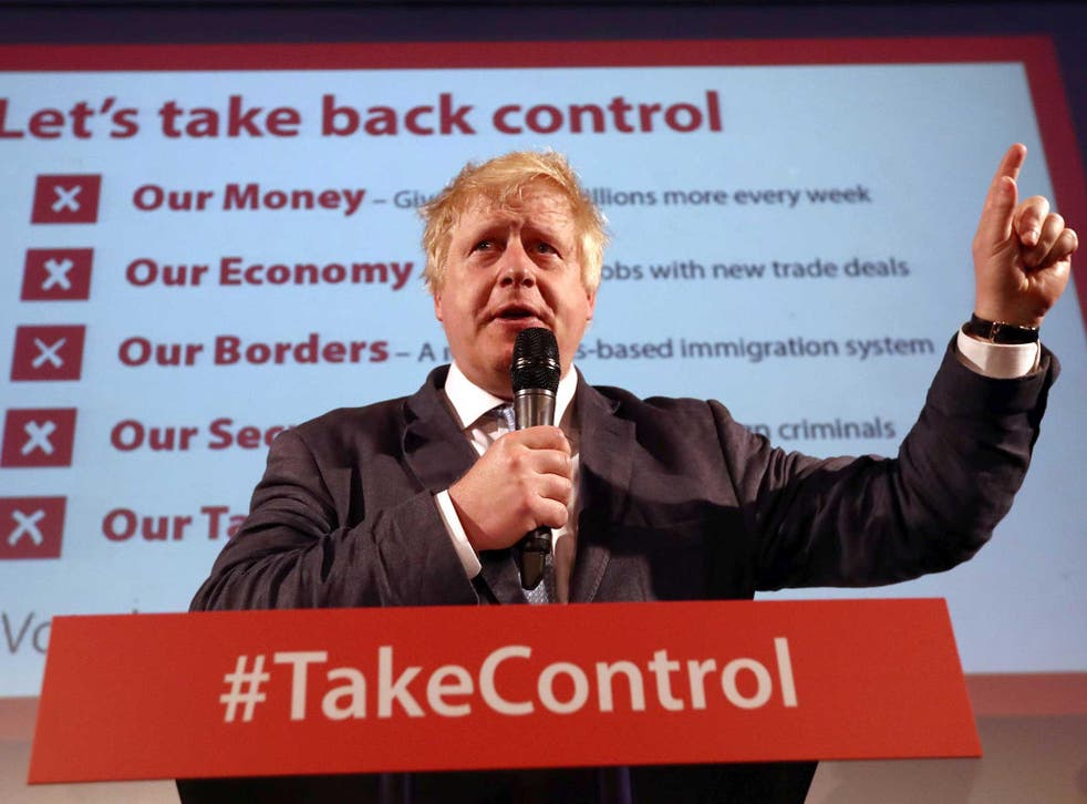 Boris Johnson talks to supporters during a Vote Leave rally in London