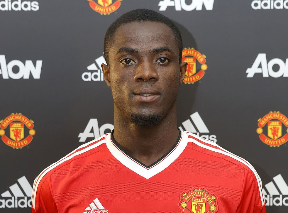 Eric Bailly poses following his £30m transfer to Manchester United