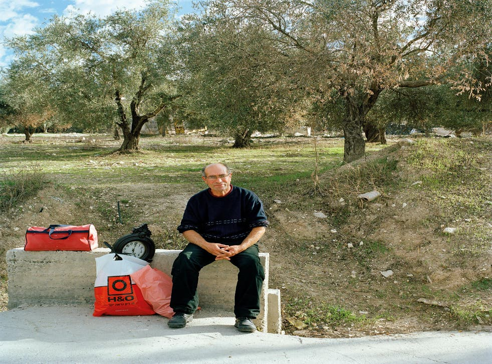 Palestinian waiting at the crossroads of Route 60 and the road to Sanur, Palestine.