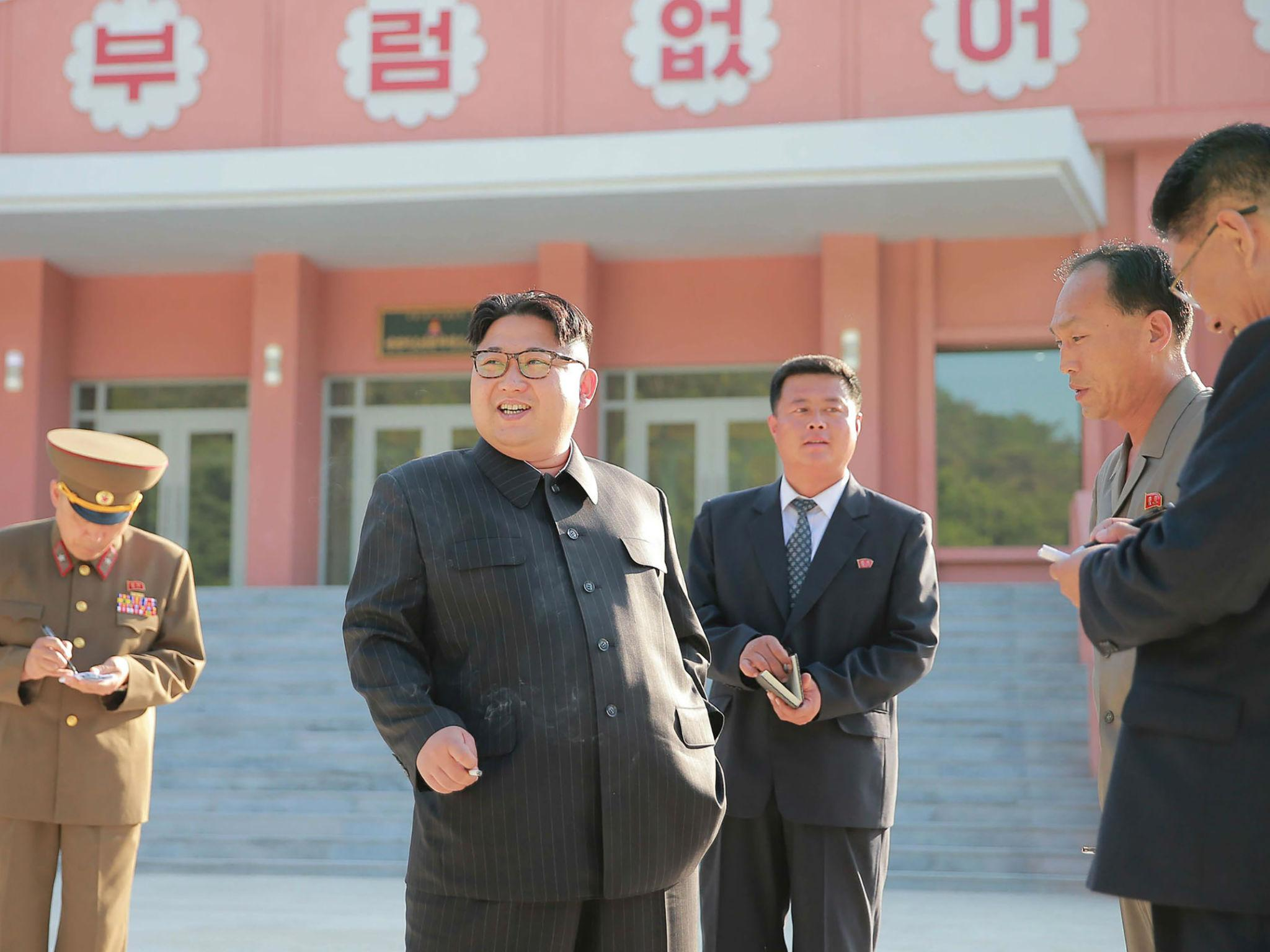 Kim Jong Un pictured smoking after North Korea launches national anti-smoking campaign | The Independent