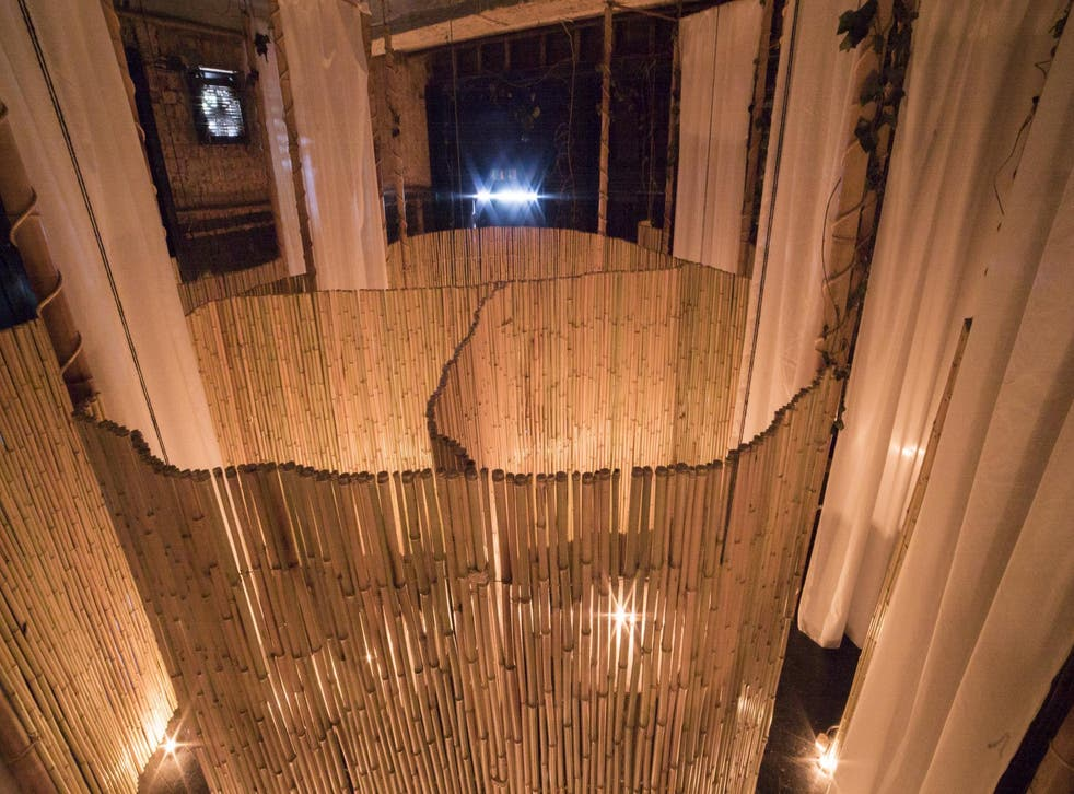 Bamboo booths separate the naked diners