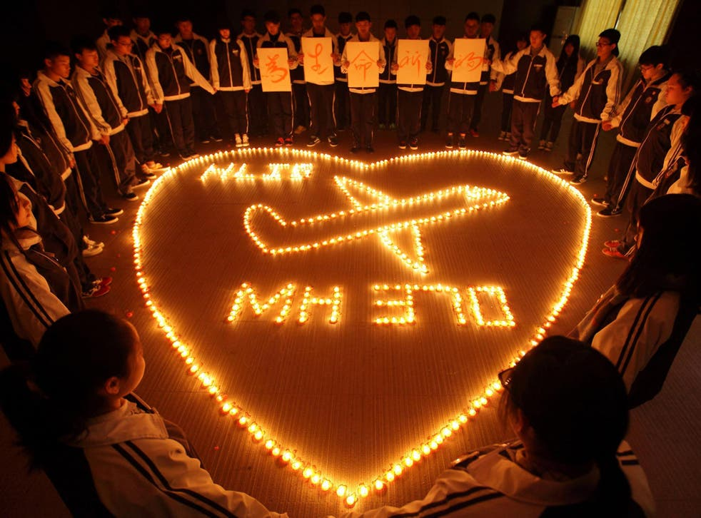 Students at Hailiang International School in Zhuji, China light candles for the passengers on the Malaysia Airlines MH370 flight, just a few days after the aircraft went missing in 2014
