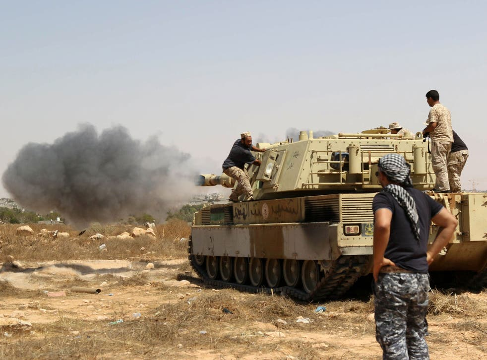 Forces loyal to Libya's UN-backed unity government fire from a tank in Sirte on Friday