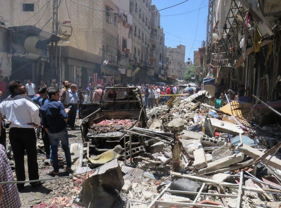 Syrians gathering at the scene of a double bomb attack outside the Sayyida Zeinab shrine