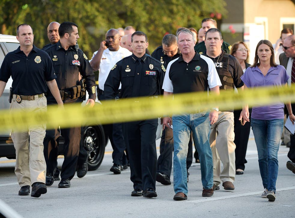 Orlando mayor Buddy Dyer attends the aftermath of the fatal shooting