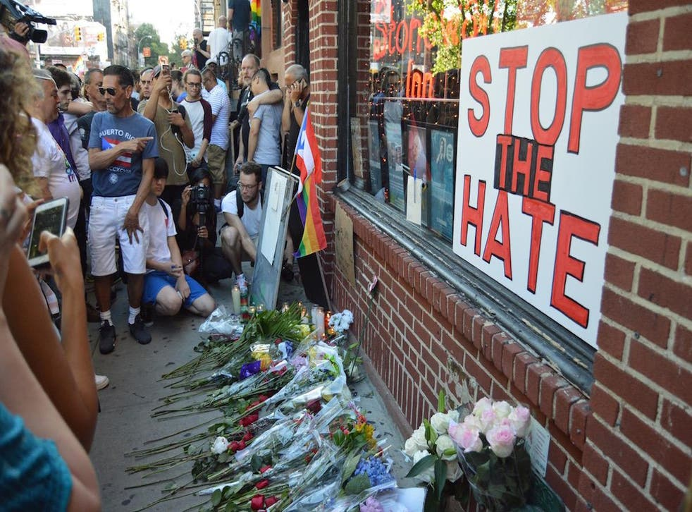 New Yorkers mourn victims of the Orlando LGBT nightclub shooting.