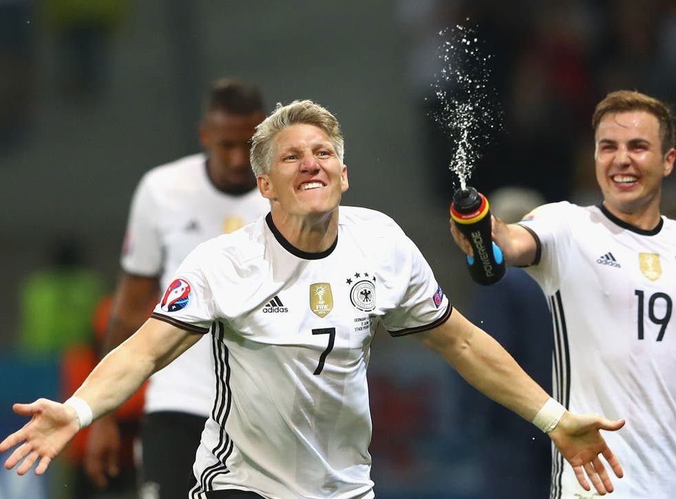 Bastian Schweinsteiger celebrates his goal for Germany against Ukraine