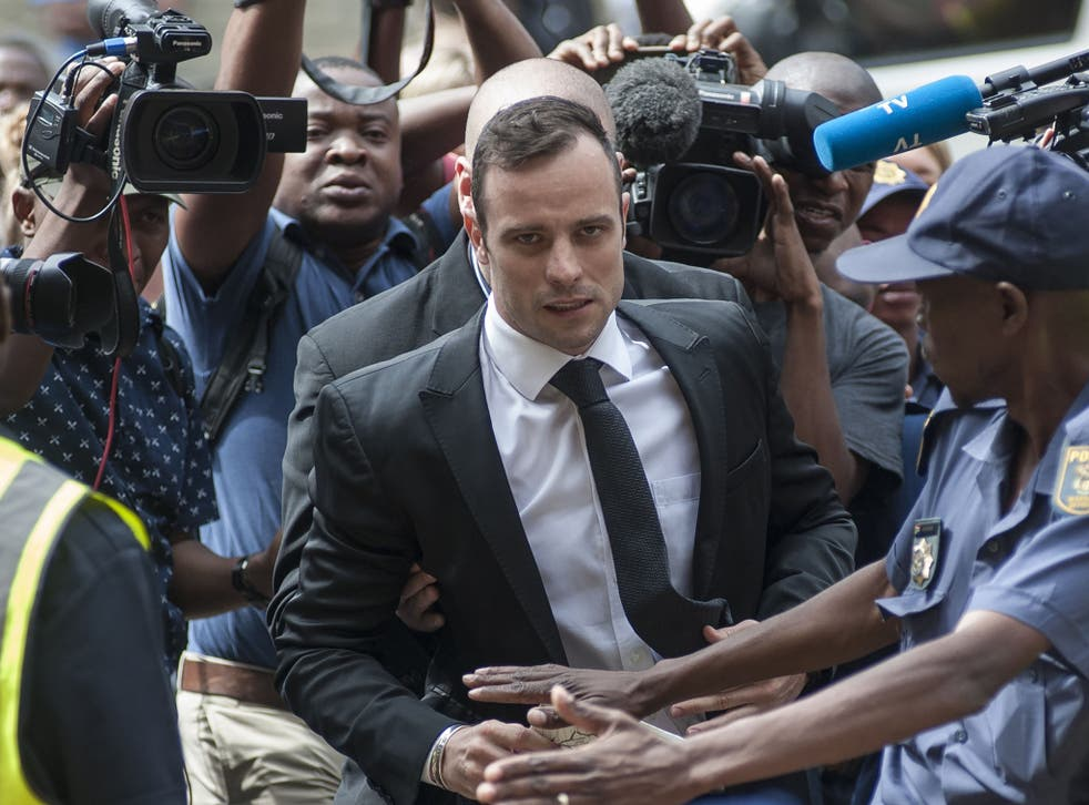 Oscar Pistorius arrives for a court appearance in December 2015 to apply for bail after his manslaughter conviction was upgraded to murder