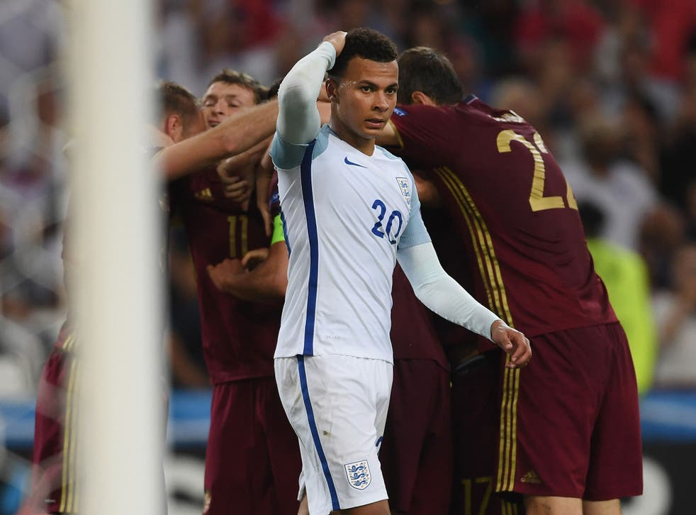 Dele Alli reacts after Russia's late equaliser