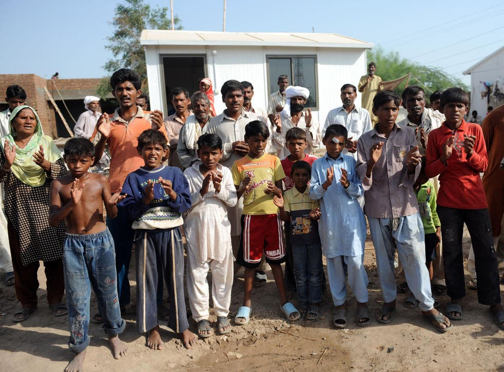 Pakistani Christians pictured praying outside homes under construction in Gojra