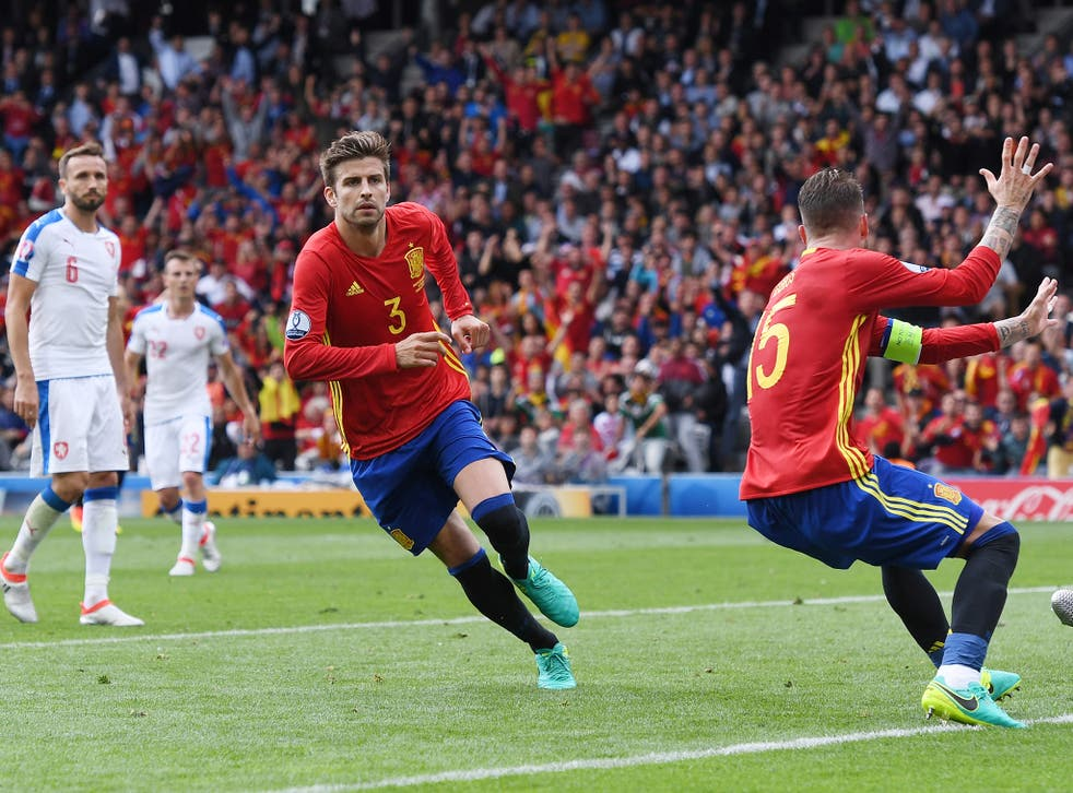 Gerard Pique turns to celebrate heading in the winning goal in Spain's 1-0 victory over Czech Republic