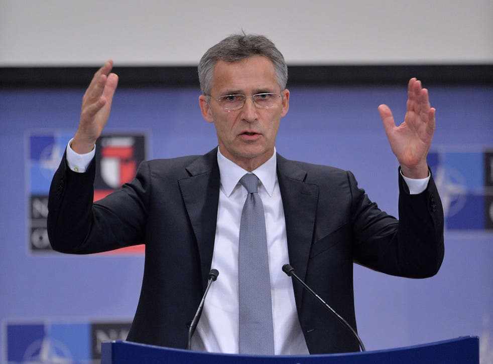 Jens Stoltenberg speaking at a press conference in Brussels