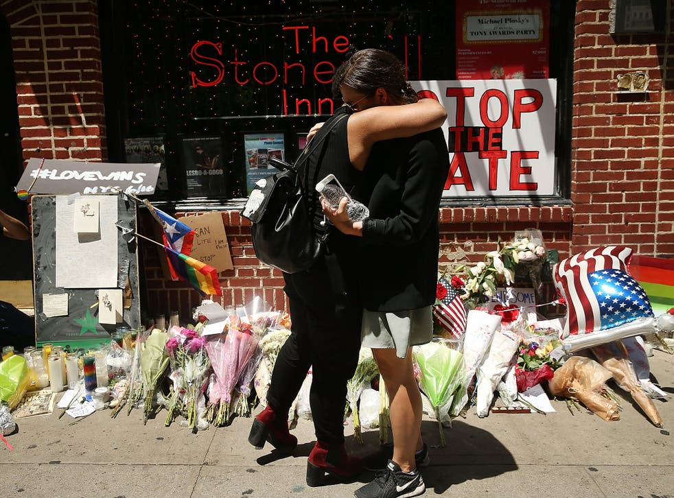 Mourners outside the iconic Stonewall Inn in New York