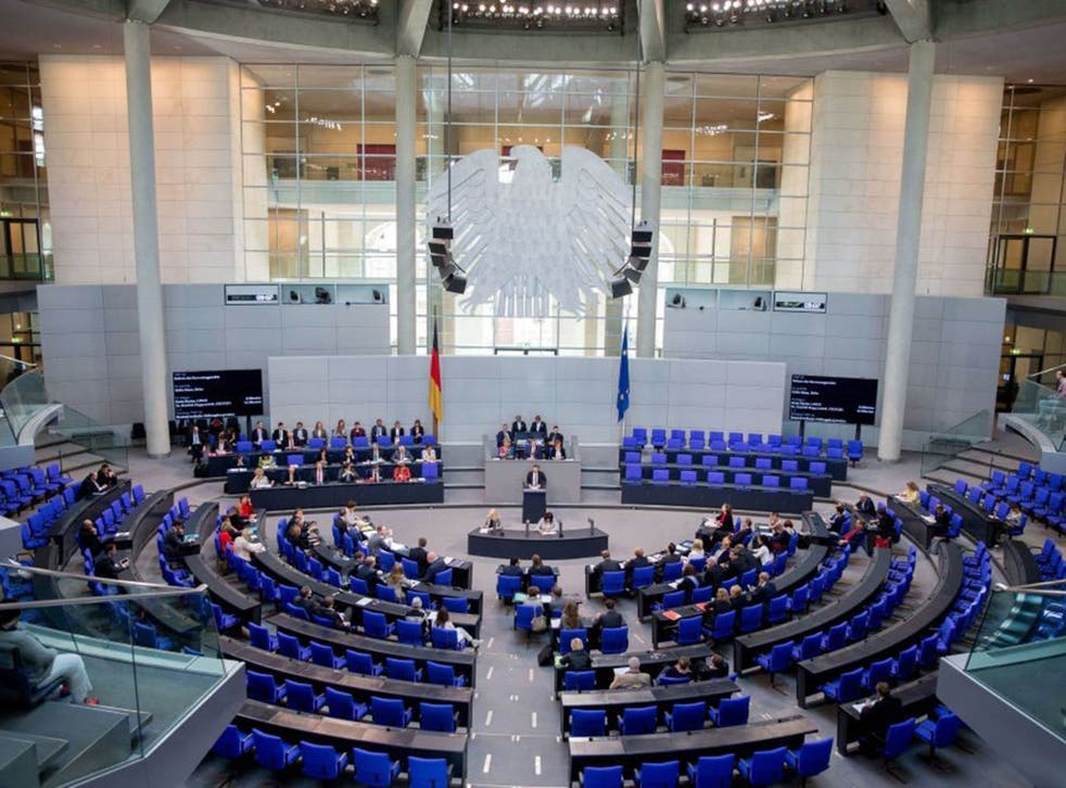 German Minister of Justice Heiko Maas (C) speaks during a session of the German Bundestag in Berlin