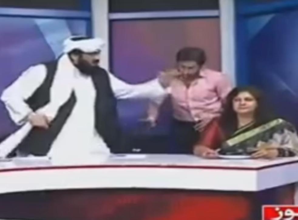 Pakistani senator Hafiz Hamdullah (left) gesticulates during a heated panel show debate about honour killings