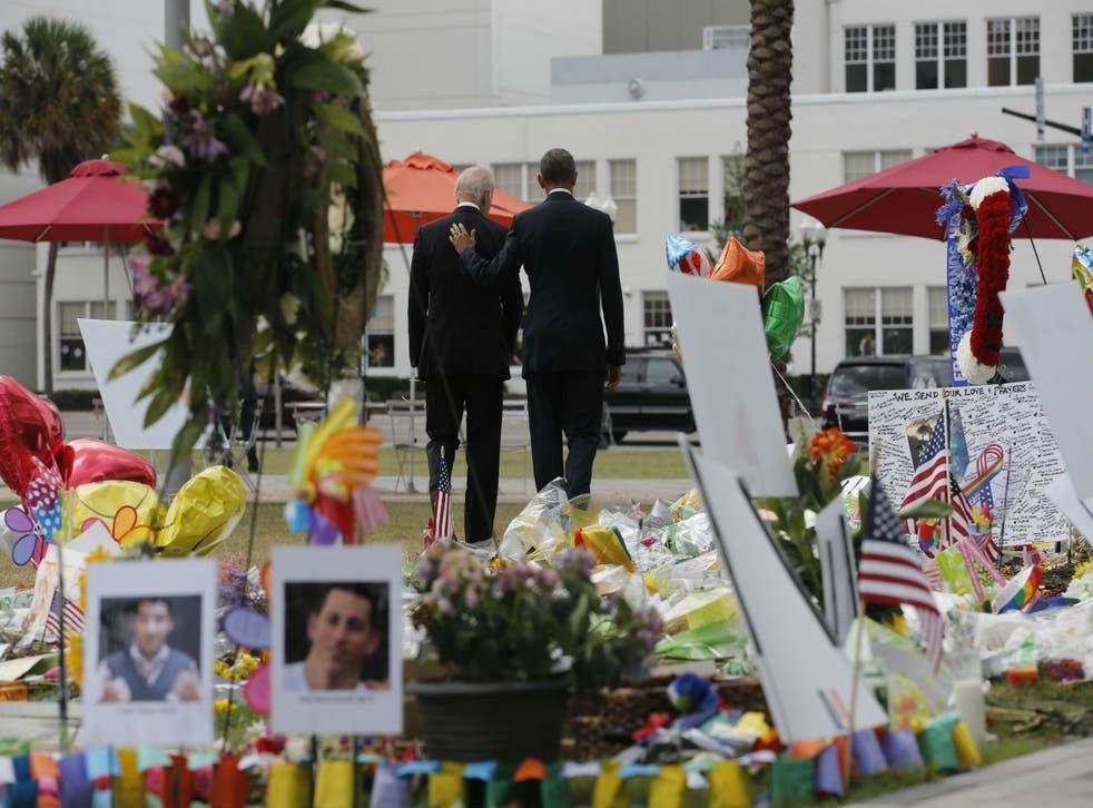 Mr Obama and Mr Biden visited a makeshift memorial in Orlando