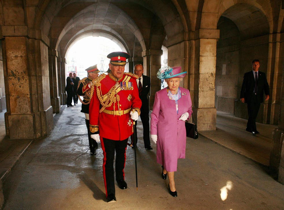 Lord Guthrie (left) former Chief of Defence Staff walks with Queen Elizabeth II at Horse Guards Parade, London