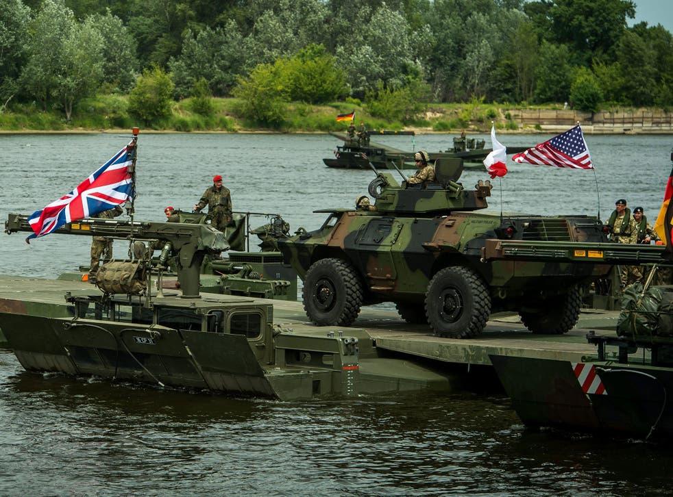 An amphibious bridge across the Vistula river during the NATO Anaconda-16 exercise in Chelmno, Poland, 13 June 2016.