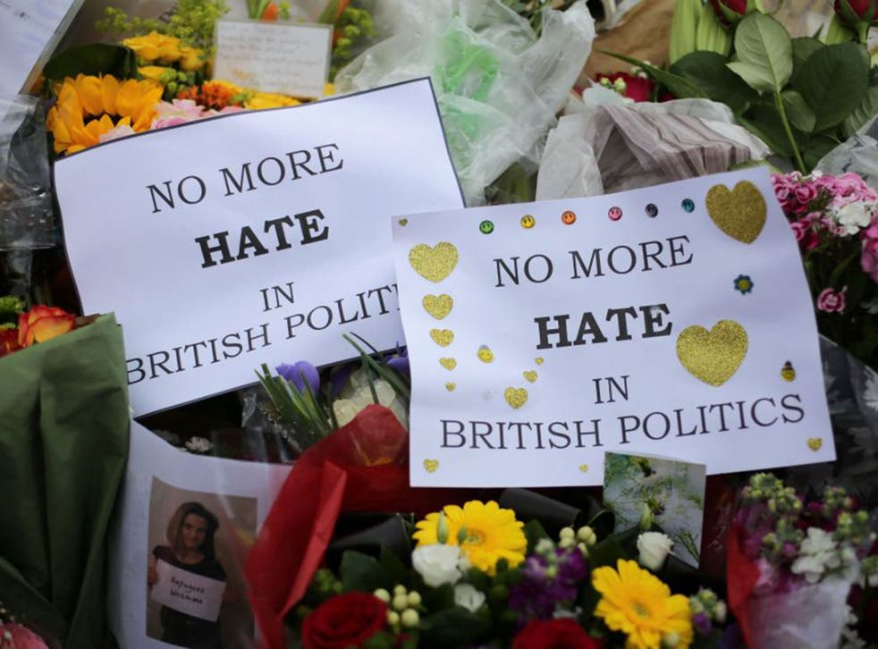 Flowers and tributes are piled in remembrance of Labour MP Jo Cox outside Parliament Square