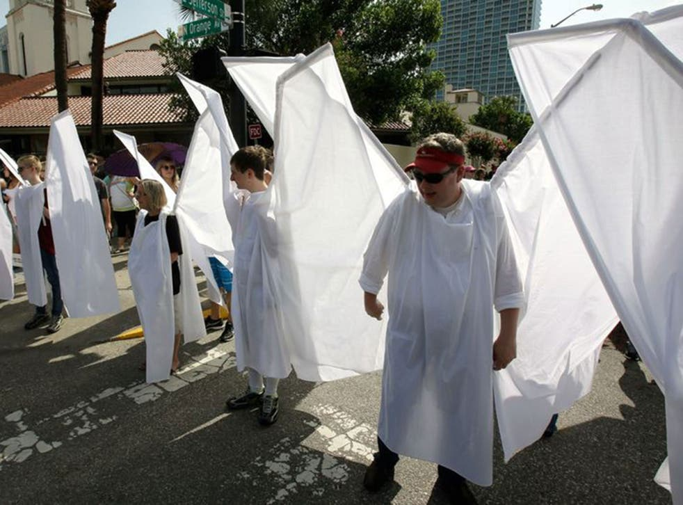The 'angels' wore large wings to block out protestors at the funerals of victims of the Orlando shootings