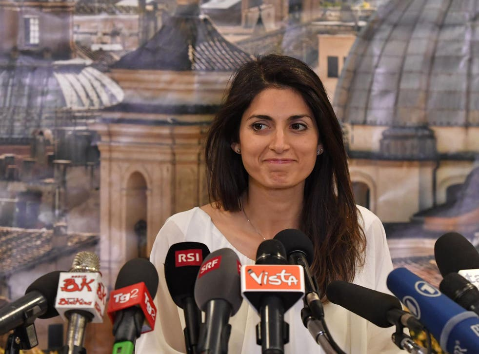 Newly elected mayor of Rome Virginia Raggi gives a press conference at her campaign headquarters in Rome