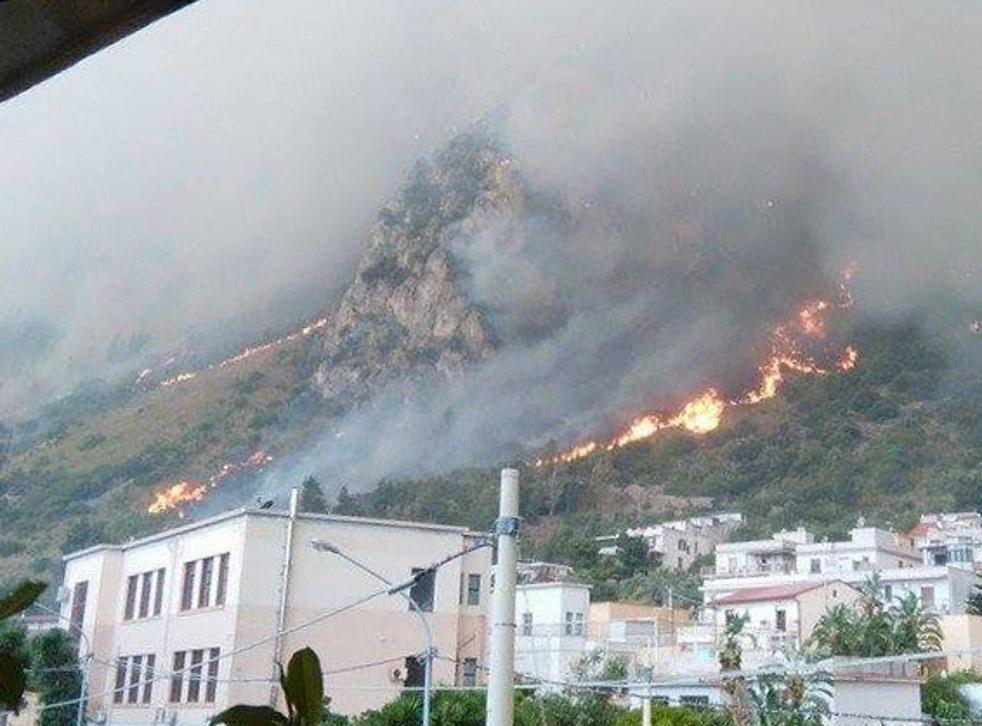 Wildfires burn in Sicily