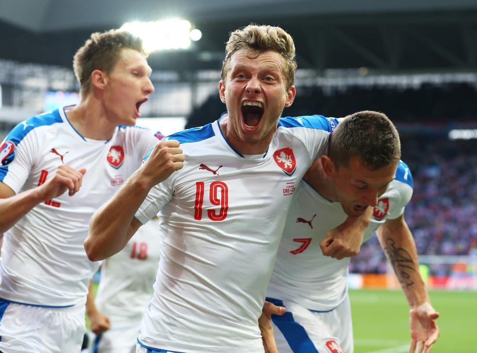 Czech Republic players celebrate their late equaliser against Croatia