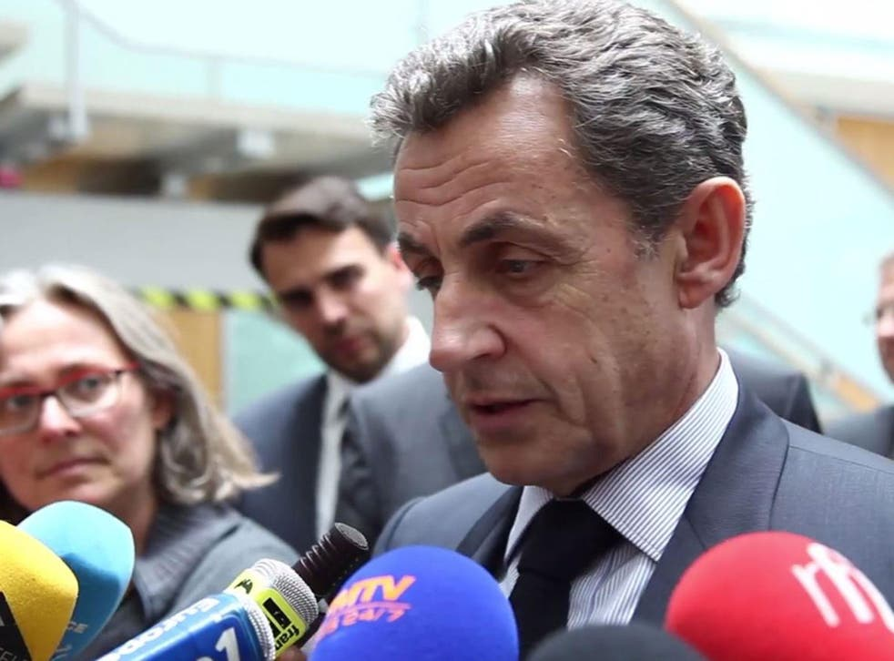 Former French President Nicolas Sarkozy spoke to reporters after meeting with German Chancellor Angela Merkel in Berlin, Germany
