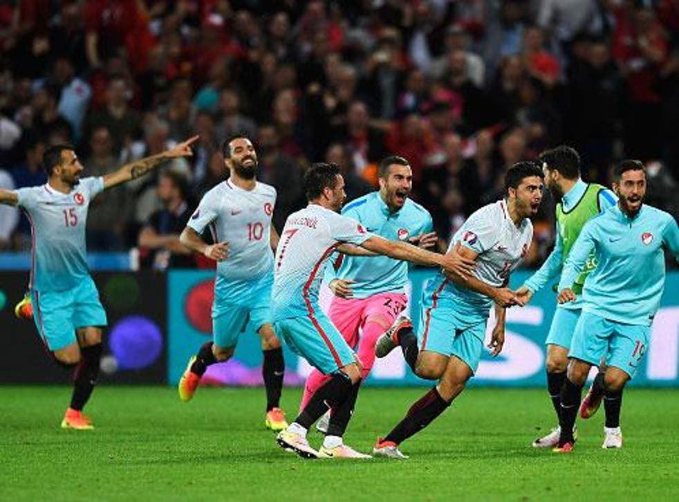 Ozan Tufan is congratulated on scoring Turkey's second goal by delighted team-mates (Getty)