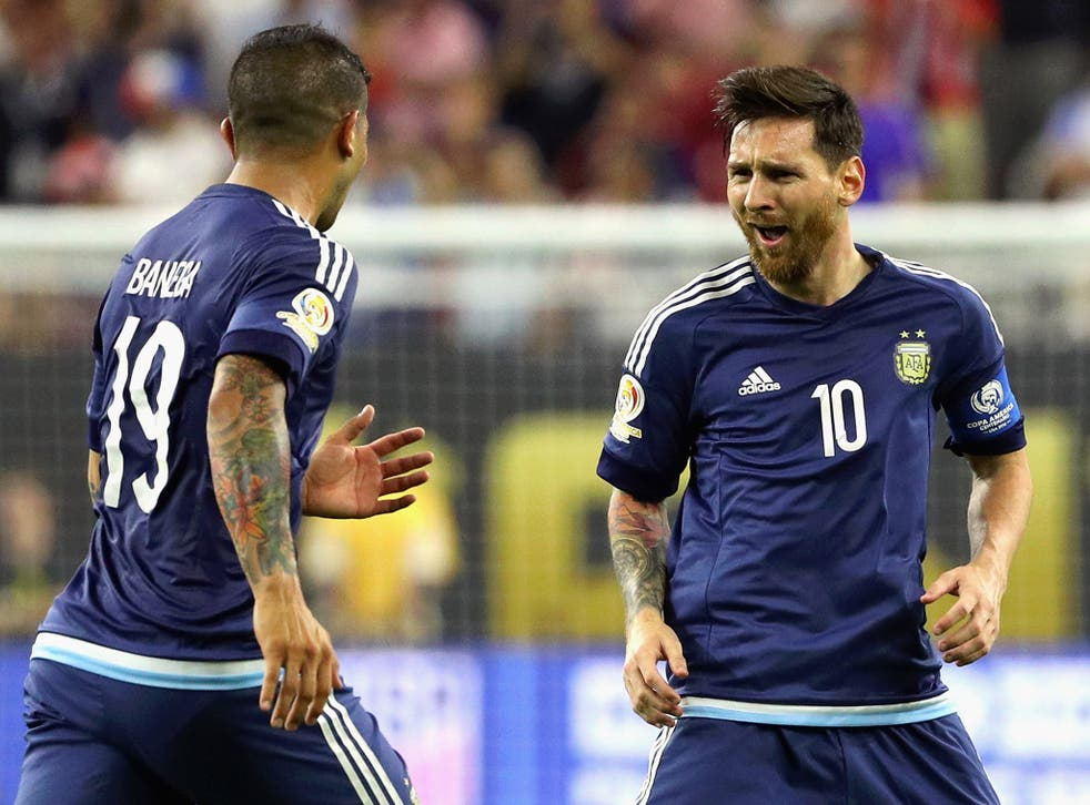 Lionel Messi celebrates after scoring a free-kick for Argentina
