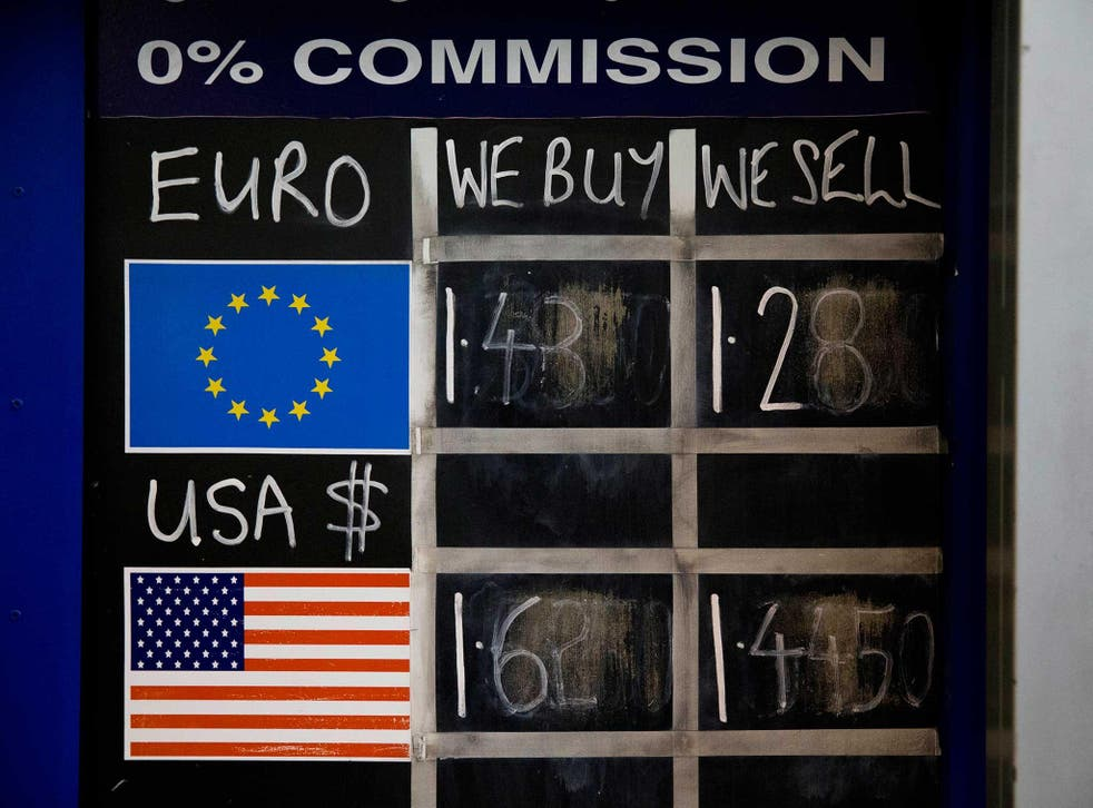 A chalk board shows currency exchange rates at a Bureau de Change in London