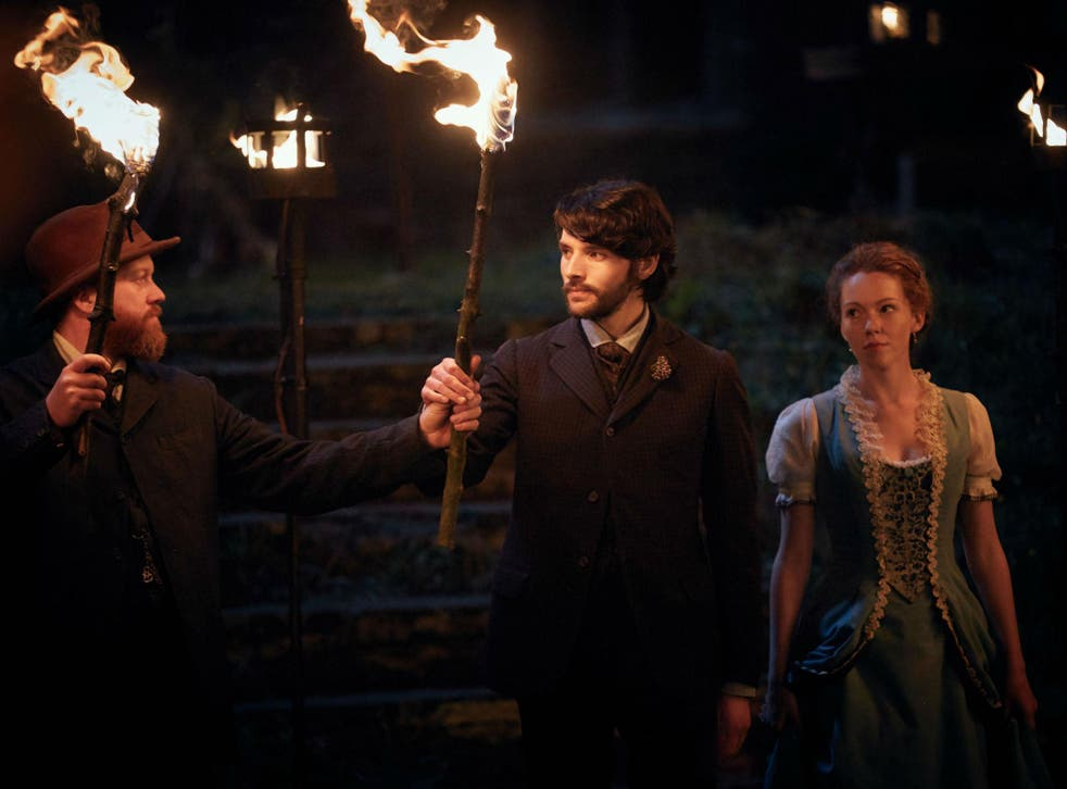 Colin Morgan (centre) and Charlotte Appleby in 'The Living and the Dead'