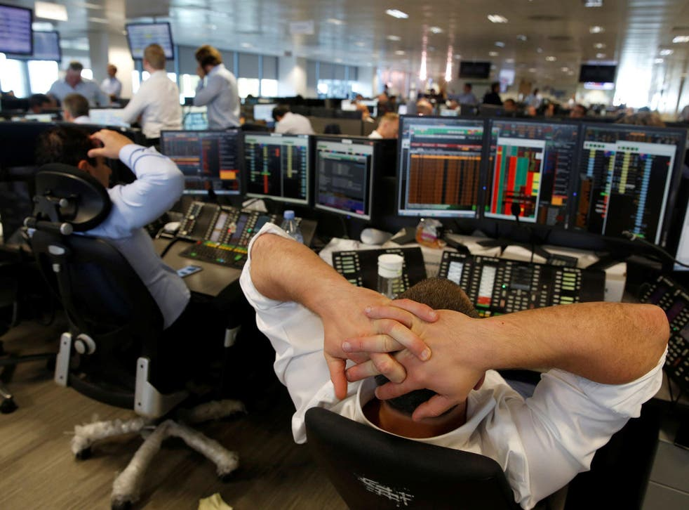 A trader from BGC, a global brokerage company in London, reacts during trading 24 June, 2016 after Britain voted to leave the European Union