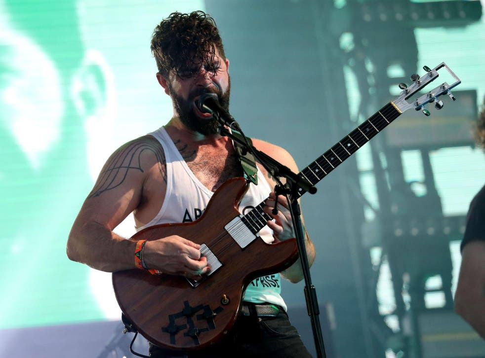 Yannis Philippakis of Foals performs on the Pyramid Stage at Glastonbury