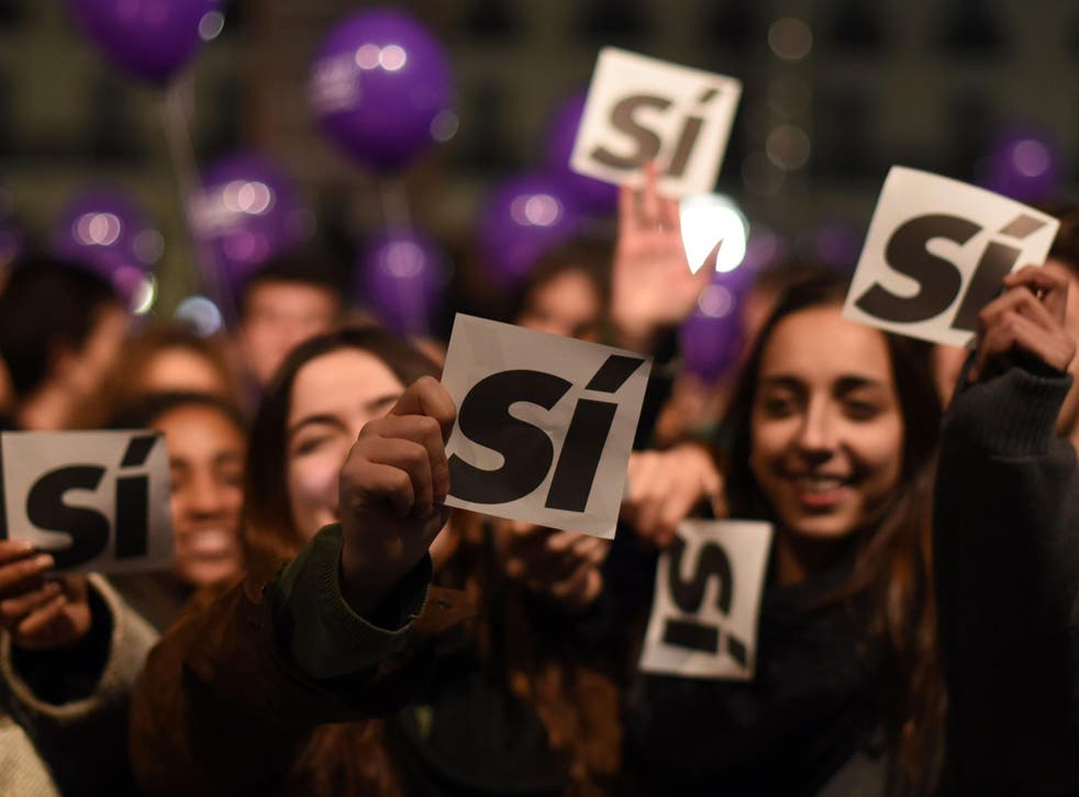 Supporters of left-wing Podemos hold sheets reading 'yes' during previous general election on 20 December