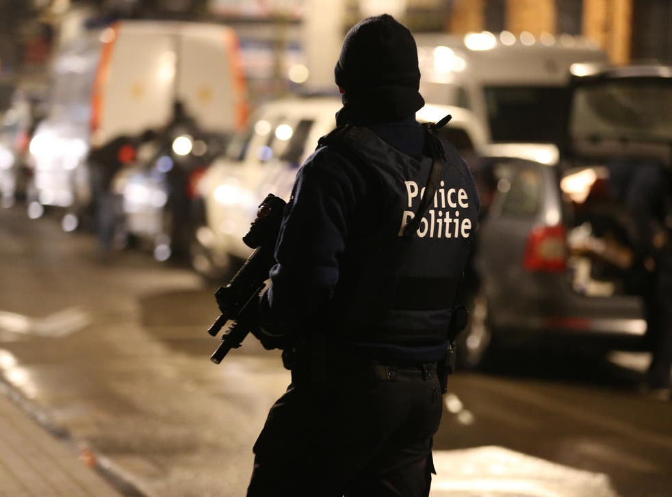 Police officers take part in an operation in Schaerbeek - Schaarbeek, Brussels, late on March 24, 2016
