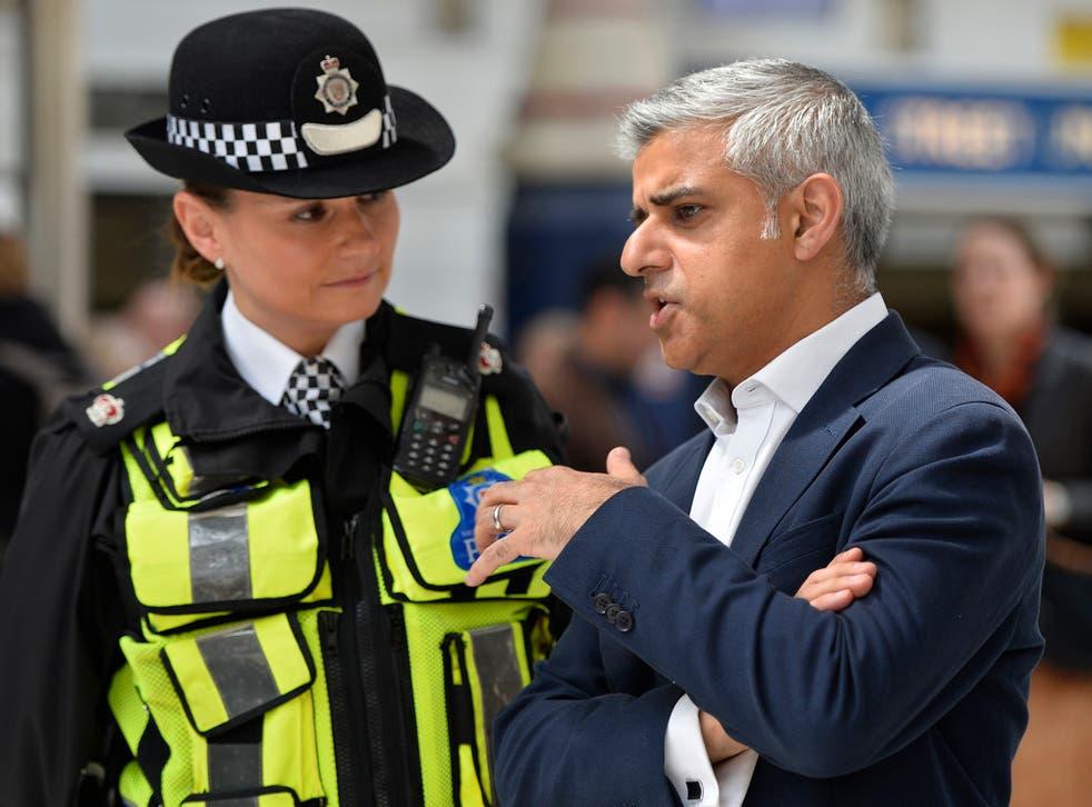 London Mayor Sadiq Khan speaking to a British Transport Police Superintendent Gill Murray