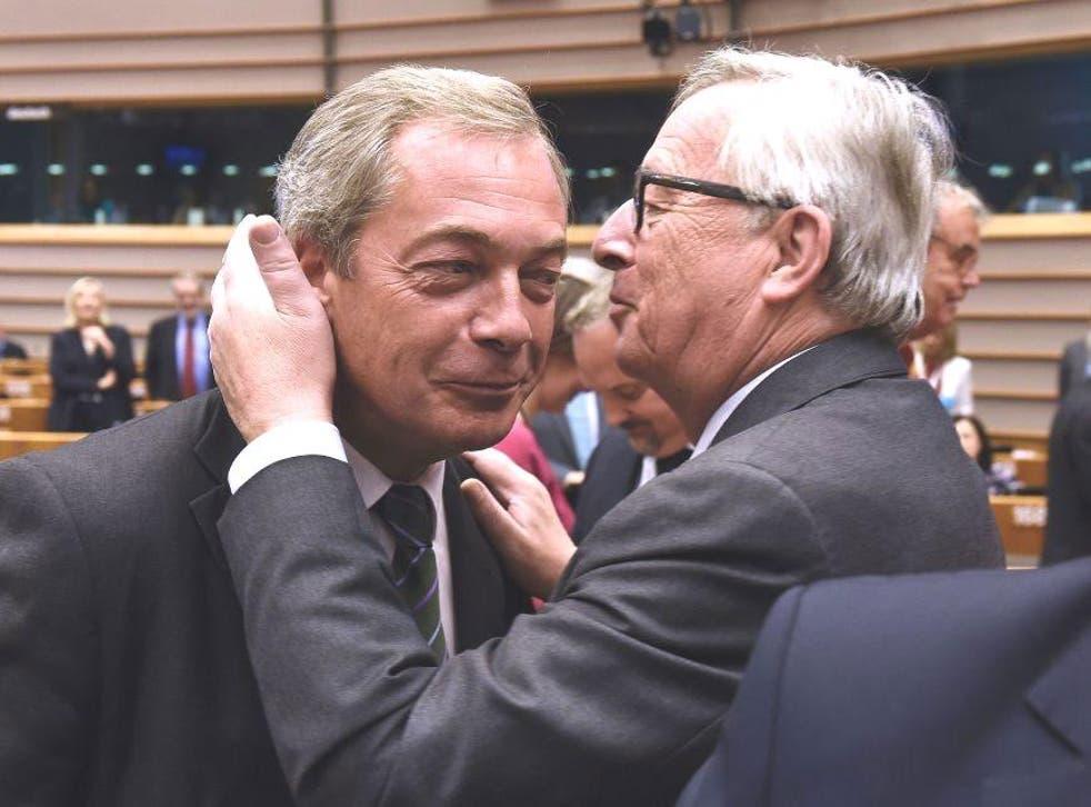 Nigel Farage shares a surprising hug with Jean Claude Juncker