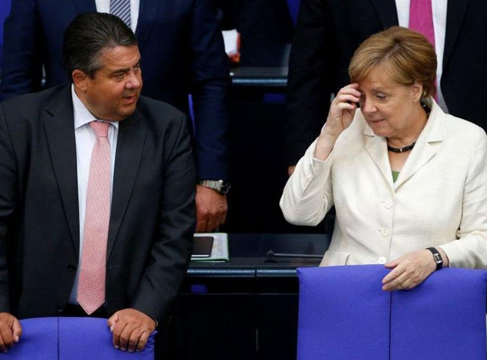 German Economy Minister Sigmar Gabriel with Angela Merkel during a debate on the consequences of the Brexit in the Bundestag