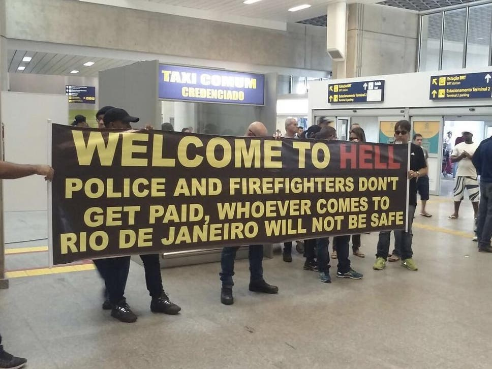 Brazilian police greet tourists with welcome to hell sign at rio rios mayor says the olympics could be a big failure due to financial crisis m4hsunfo