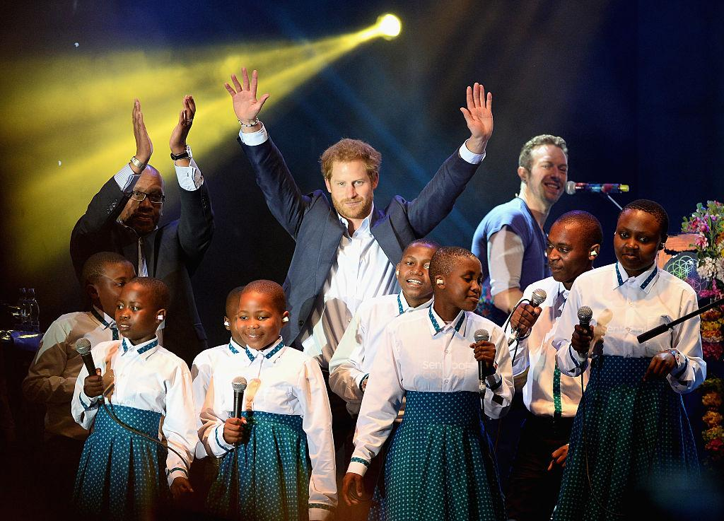Prince Harry joins Coldplay for duet at HIV charity concert