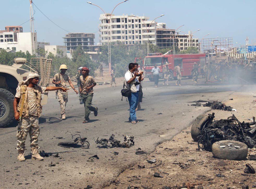 Soldiers gather at the site of a car bomb attack in a central square in the port city of Aden, Yemen, May 1, 2016
