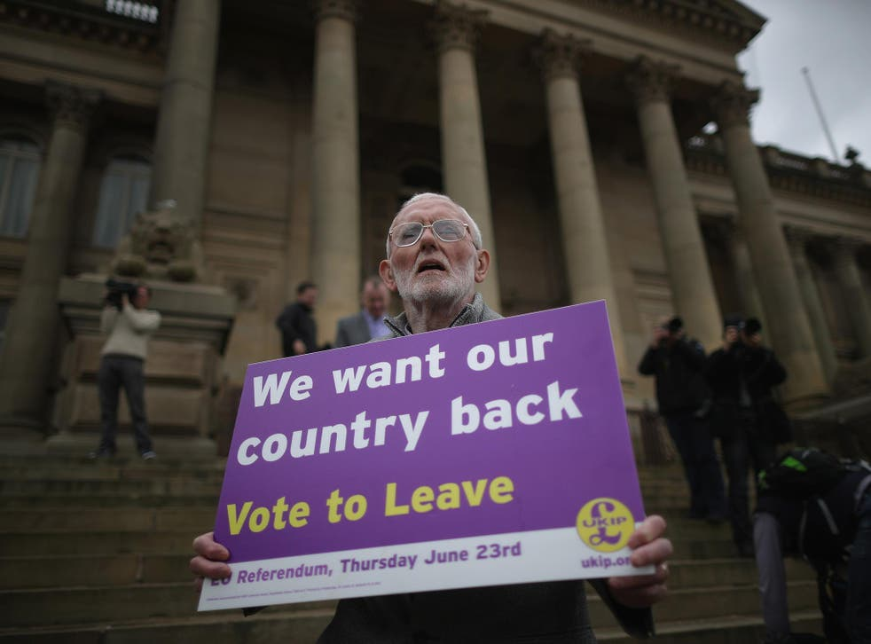 A Vote to Leave campaigner holds a placard in support of leaving the European Union in Bolton, England