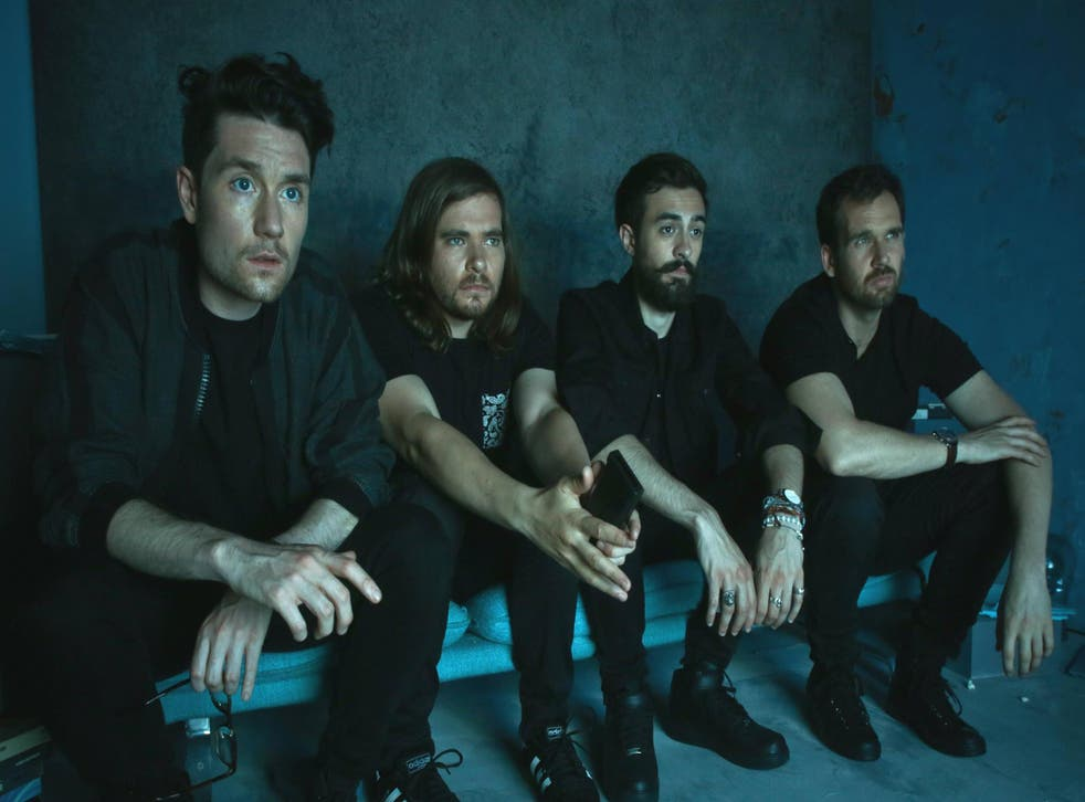 Bastille's Will Farquarson (far right) says their new album will be 'quite disorientating'