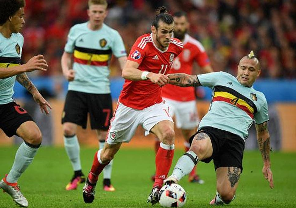 Gareth Bale is tackled by Belgium scorer Ranja Nainggolan in Lille on  Friday night (Getty 83a44ec9a
